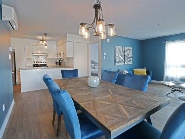 Domaine Pointe de l'Île - New condos in Pointe-aux-Trembles with model units move-in ready with elevator with outdoor parking with pool