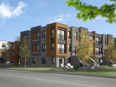 Habitat Véridis - triplex Horizon par KF Construction - Condos neufs à Laval avec stationnement extérieur